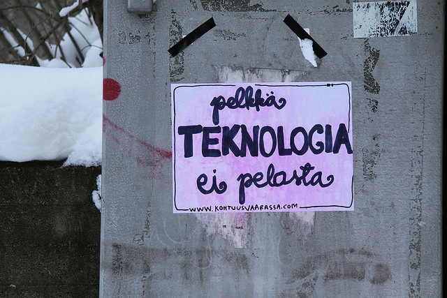 """Technology alone is not a solution"" message sticker in Kuopio."