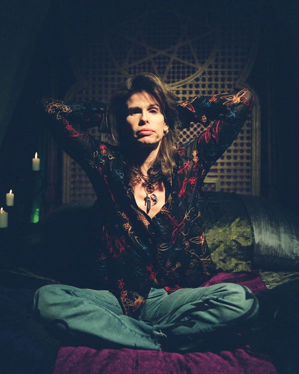 Steven Tyler. Hahaha just realize that this is my style when i feel medium happy but very content at the same time
