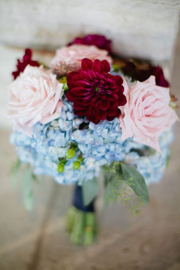 Beautiful mixture of light pink, maroon, and blue for bridesmaid bouquets.