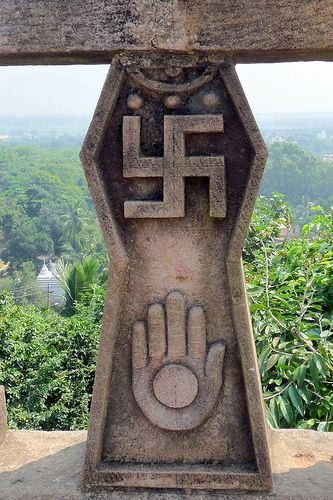 The Swastika Its use in India dates back to the Indus Valley Civilization city of Harappa, and came to represent Vishnu in Hinduism.[4][1] In Chinese Taoism, the swastika is a symbol of eternity. For Tibetan Buddhism, it is emblematic of the element of Earth.[4] It is a common practice for Hindus to draw Swastika symbols on the doors and entrances to their houses during festivals, which is believed to symbolize an invitation to goddess Lakshmi.