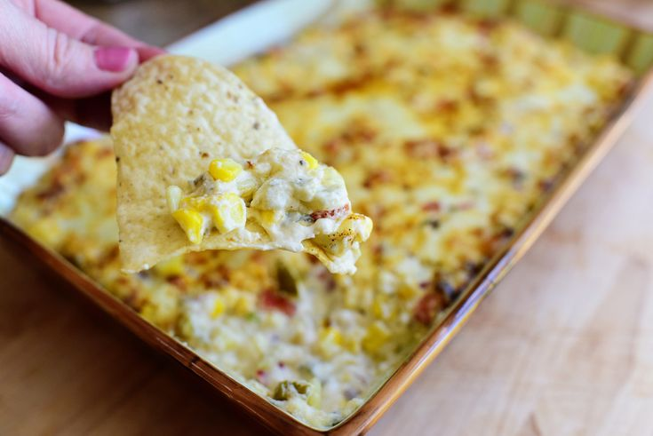 Hot Corn Dip is one of those things that can cause me to completely embarrass myself at parties, as if putting my leg behind my head to show off my residual ballet flexibility isn't embarrassing enough. This dip is positively to die for, and you can make it ahead of time and keep it in the fridge before baking it if that works better for your schedule.