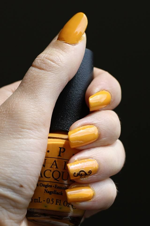 Desiree with a yellow nail and feature decal