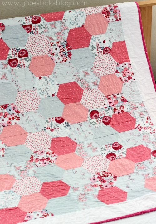 Simple Hexagon Quilt: Half hexagons are stitched together in strips to create the classic hexagon quilt pattern. Bold, beautiful, and perfect for beginners.