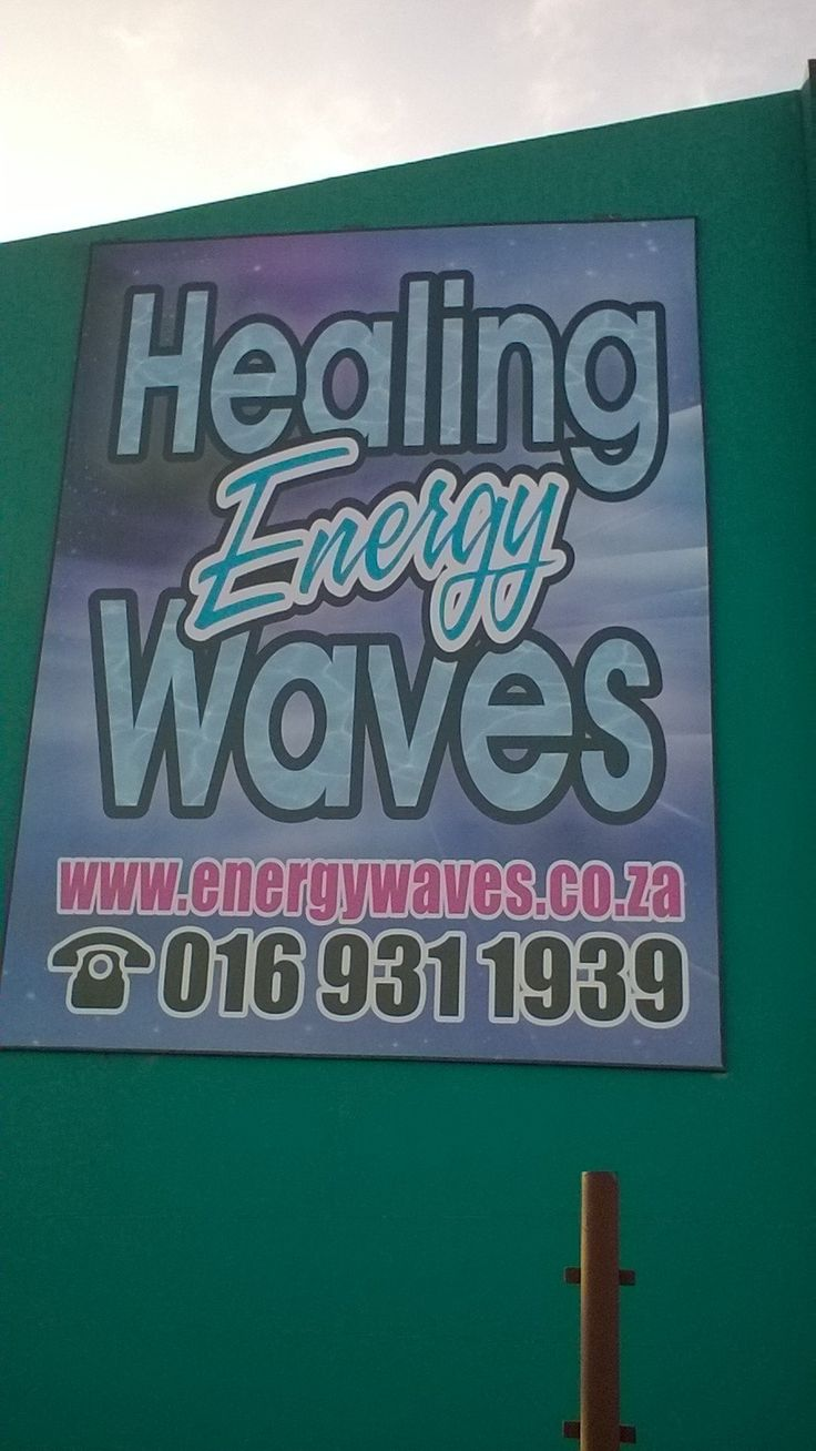Healing energy Waves banner on the one side of the building - Vanderbijlpark