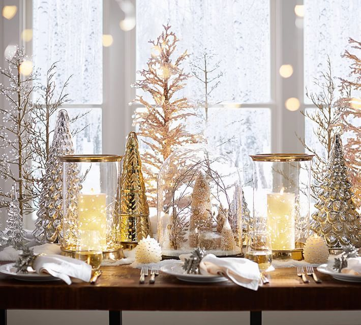 Create a fanciful holiday dinner centerpiece using hurricanes and glass ornaments that match your other holiday decor.:
