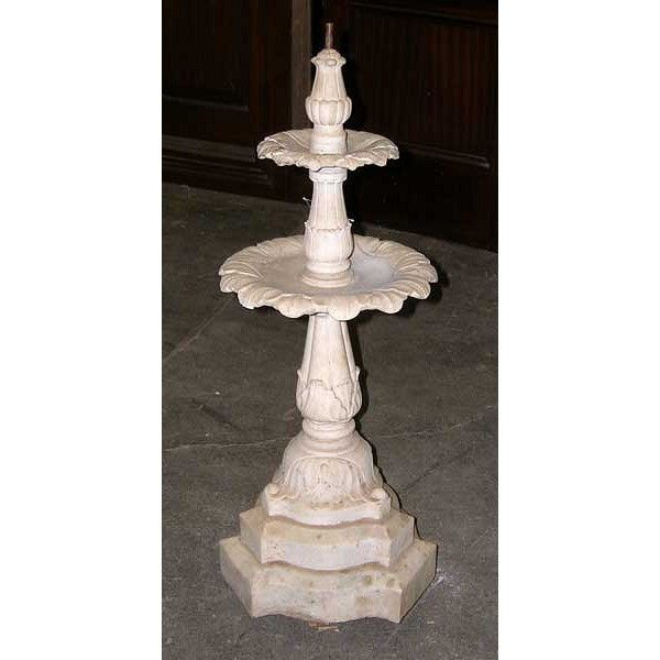 Small Victorian Marble Garden Fountain  This fountain was hand carved of white marble. It has two tiers; all parts featuring leafy arrangements. The base is an interestingly shaped triform plinth. It is an unusually small size and will be perfect for a city garden. It would also make a lovely statement indoors as part of a solarium setting. circa 1890