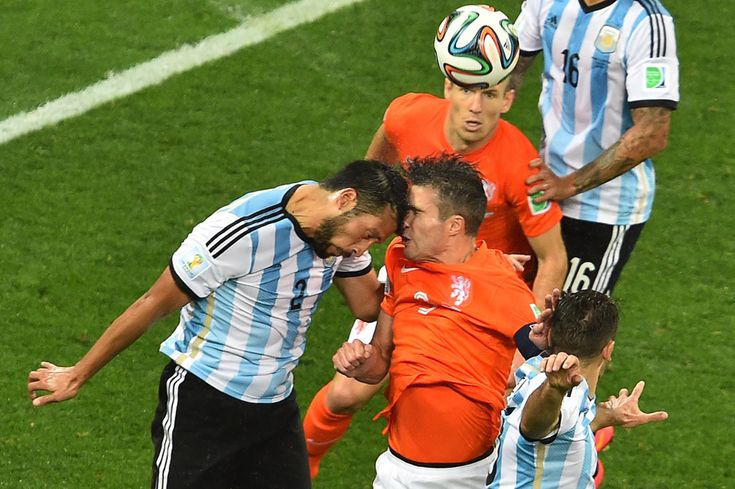 Argentina's defender Ezequiel Garay (left) vies with Netherlands' forward Robin van Persie (right) during the semifinal. (Gabriel Bouys/AFP/Getty Images)
