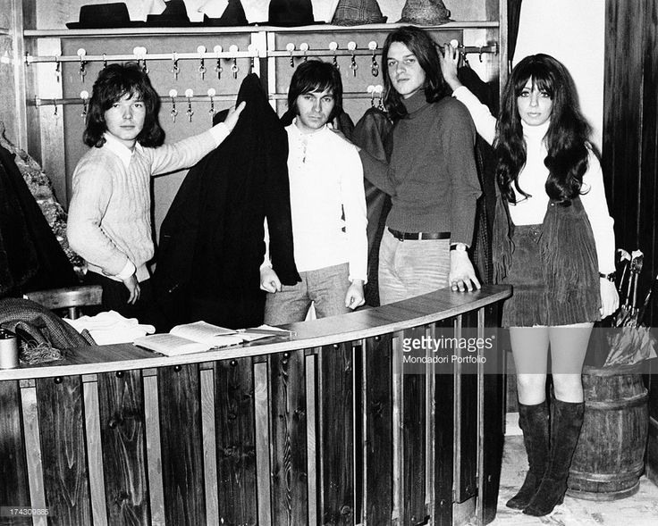 The four members of the Shocking Blue take the coats at the wardrobe's desk of a restaurant; the Dutch rock band reached number one in U.S. chart with the song Venus. Milan (Italy), 1970..