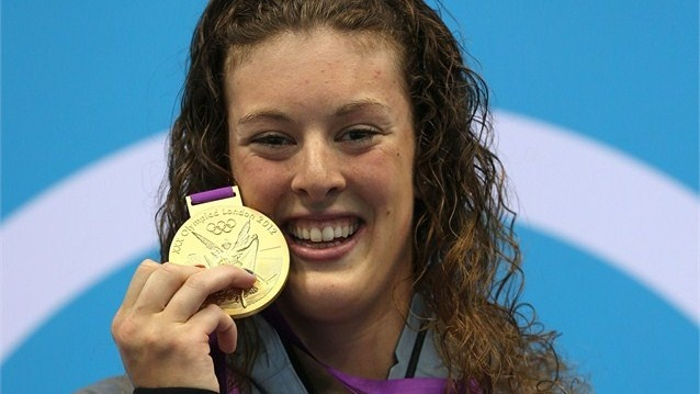 Allison Schmitt of the United States poses on the podium after taking gold in the 200m Freestyle