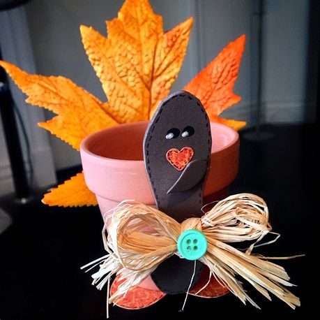 Learn how to make a terra cotta pot turkey craft using a maple leaf! This is a cheap and cute Thanksgiving decoration that even older kids can make!