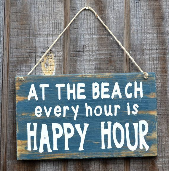 """""""At the Beach every hour is Happy Hour"""" sign"""