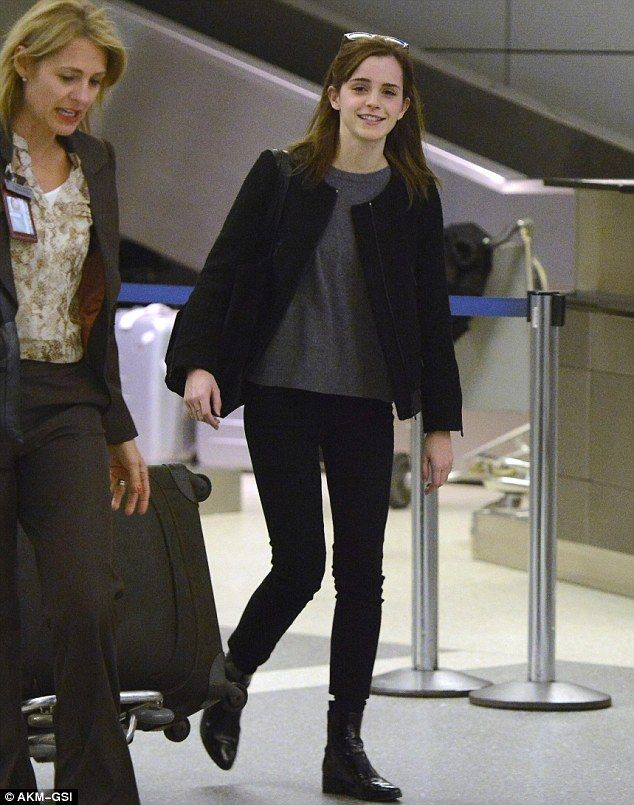 A jet-lagged Emma Watson gets photo bombed by goofy fan at LAX Sunday