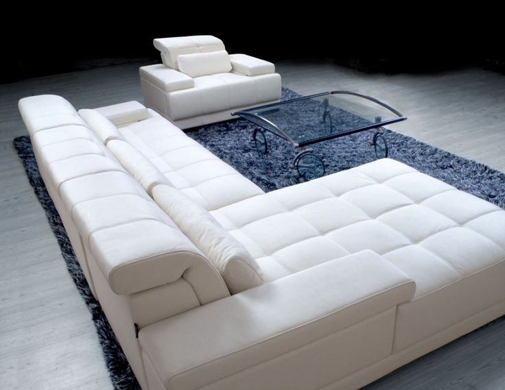 Furniture Comfortable White Leather Sectional Sofa With Glass Coffee Table On Blue Fur Rug The Attractive