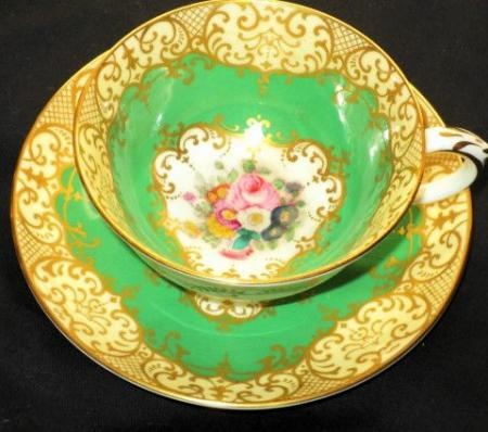 CROWN STAFFORDSHIRE ENGLAND GOLD GREEN PINK ROSE BOUQUET TEA CUP AND SAUCER