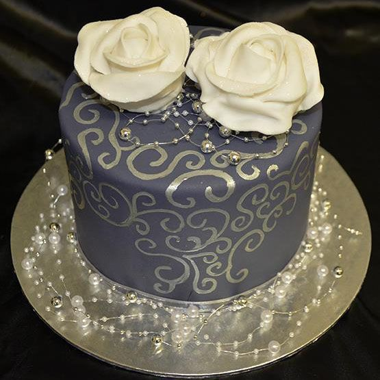 The Cake Artists - Bridal cake, purple with silver detailing and white roses