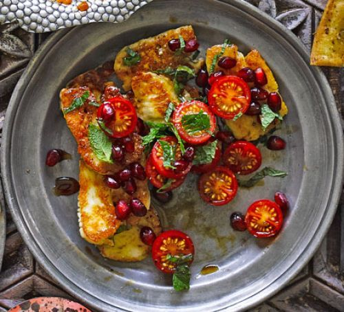 Halloumi with tomatoes & pomegranate molasses: Slice 225g pack halloumi; coat with 1-2 tbs olive oil and ½ tsp za'atar. Griddle 1-2 min, flip. Add 5 halved cherry tomatoes, cook 1-2 min. Serve over tabbouleh, drizzle with pomegranate molasses, a handful of mint leaves and 1-2 tsp pomegranate seeds.   tony Kitous, BBC goodfood