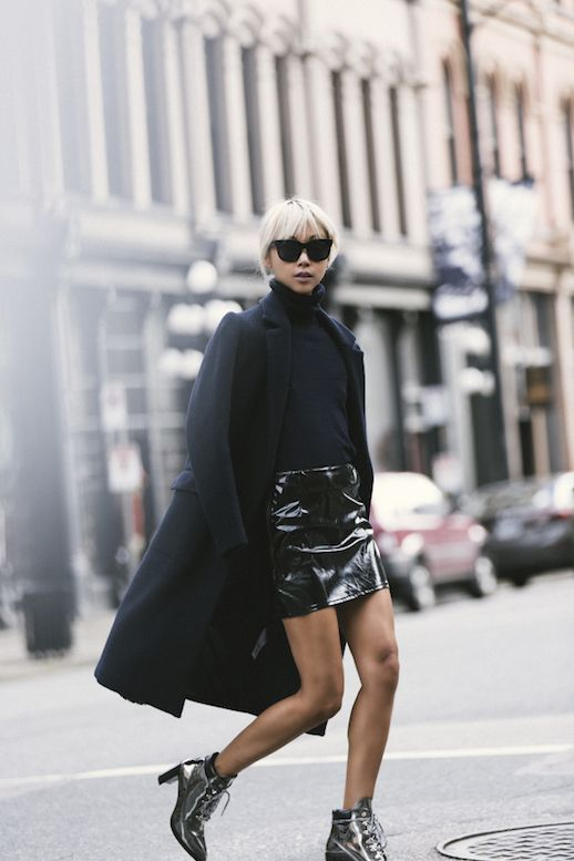 Patent leather was one of fall's top trends, and for good reason. The fabric has the ability to make any piece edgy, especially the feminine mini skirt. This blogger wore her patent leather mini with a long black coat, black turtleneck and silver statement heels.