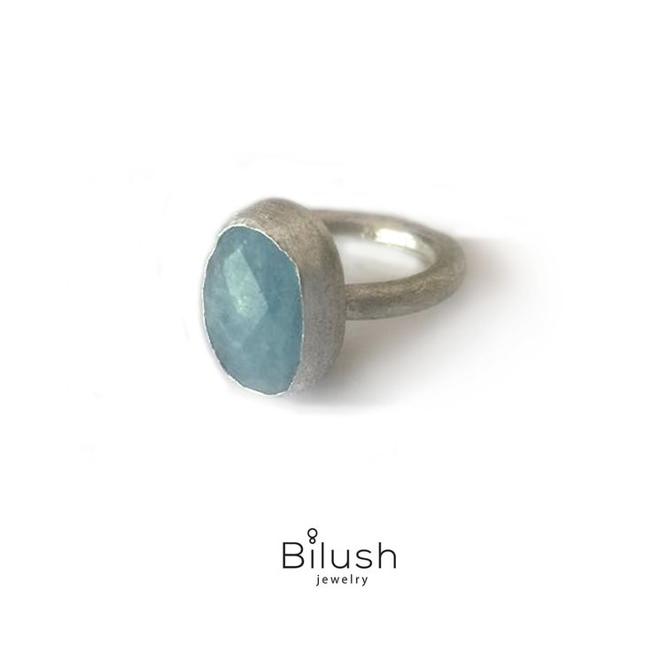 Handmade beautiful silver ring with faced milky aquamarine gemstone.