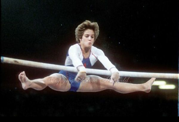 May 15, 1983; Los Angeles, California, USA; Artistic gymnast Mary Lou Retton of USA performs release move on uneven bars at USA vs USSR dual meet at Los Angeles