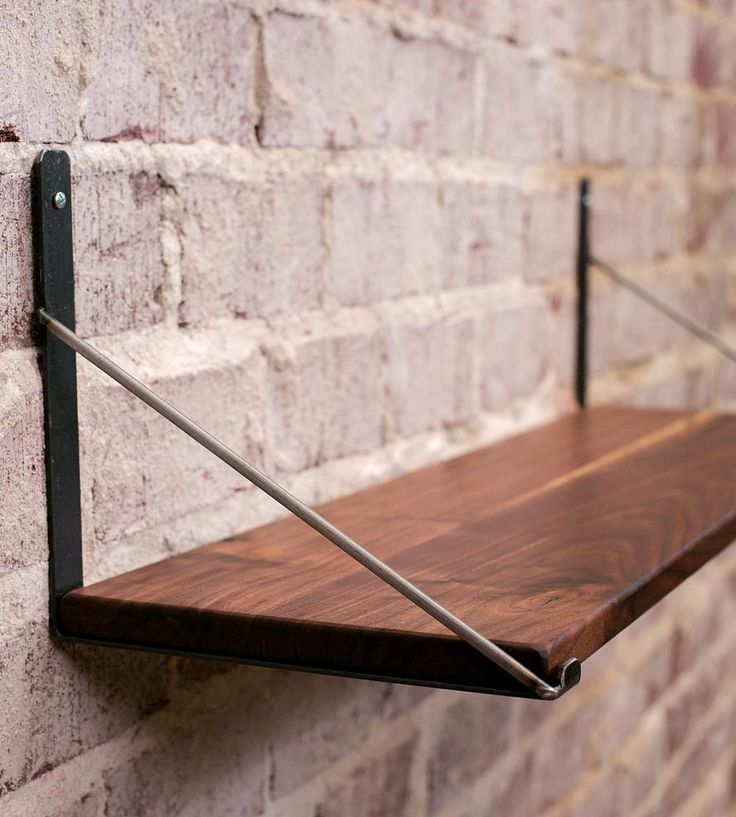 Wood Bracket Shelf | Fitted with sturdy metal brackets, this wall-mounted shelf is ... | Wall Shelves & Ledges