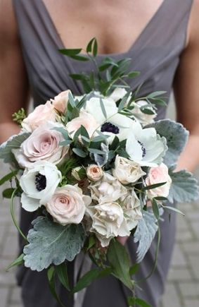 Rustic bridal wedding bouquet of anemones, roses, pale greens, with a grey bridesmaid dress