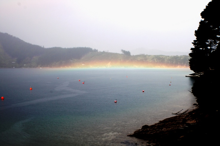 Mother nature at her finest. -A rainbow resting on the sounds in front of Bay of Many Coves Resort