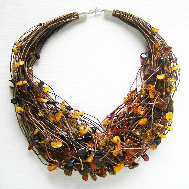 Necklace   Michal Malysz.  Amber pieces on beige and brown linen yarn.