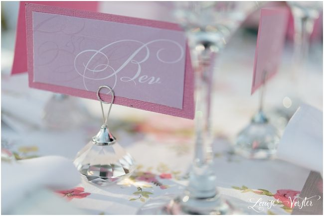 Another view of the pink name place card on a crystal name place card holder.