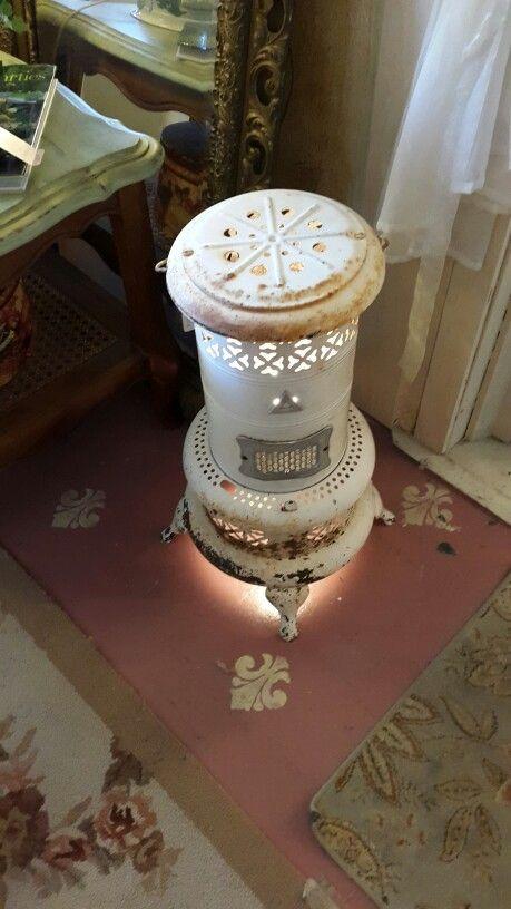 Old kerosene heater repurposed into a light.