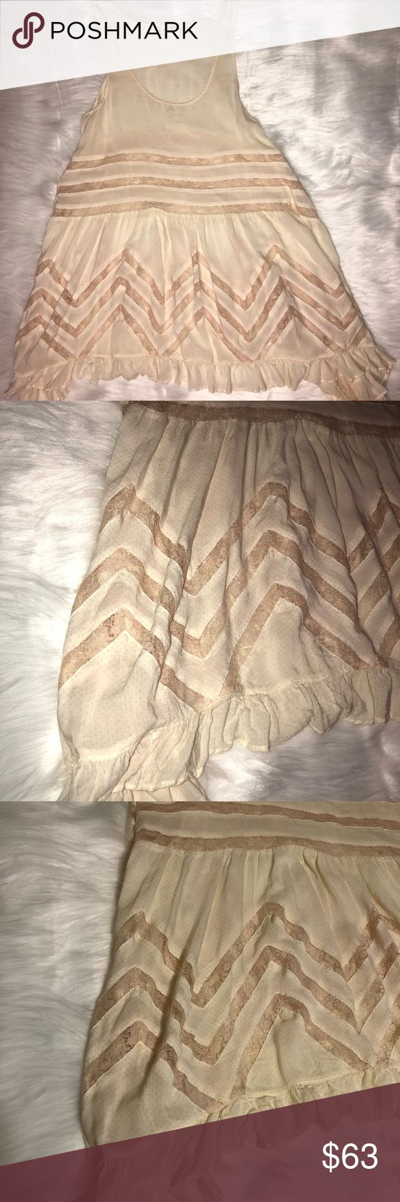 Free People Trapeze Slip Free People Trapeze Slip Size: Small Color Tea (kind of an off white with a yellow tint)  Used but in excellent condition  Lace detailing and ruffle trim Free People Dresses Mini