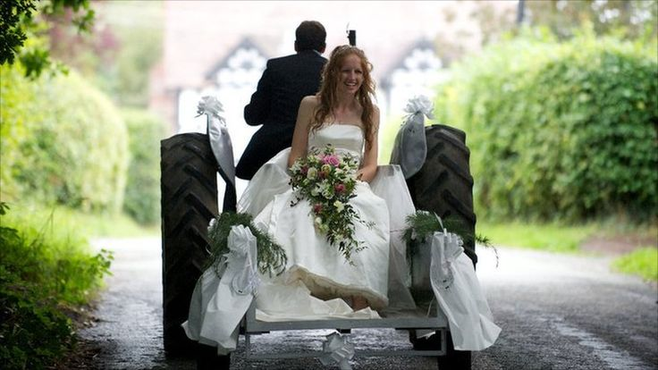 Abigail Clutterbuck-James on back on a tractor