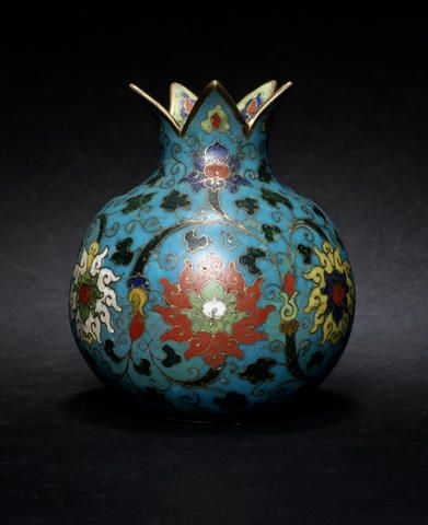 A small, cloisonné enamel vase Ming Dynasty A small, cloisonné enamel vase Ming Dynasty Of pomegranate form, decorated with scrolling lotus above waves, all reserved on a turquoise ground, the interior of the rim enamelled in green. 11.5cm (4½in) high Sold for £12,500 inc.premium (US$ 20,082)