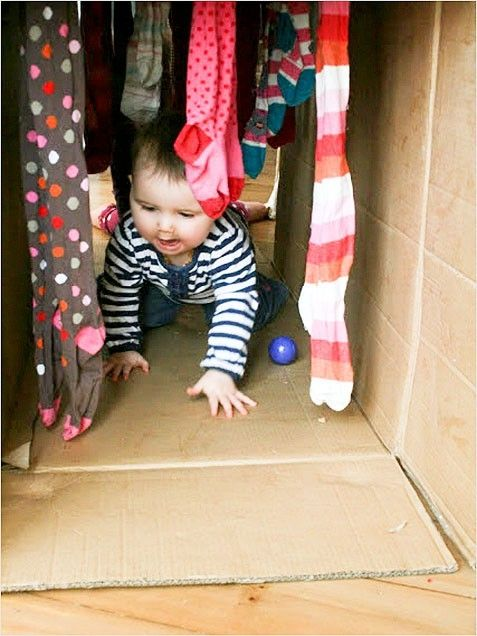 The BCW Lady says: Open up a box and hang socks or other soft items from top.  Presto - a Crawl-Through Tunnel