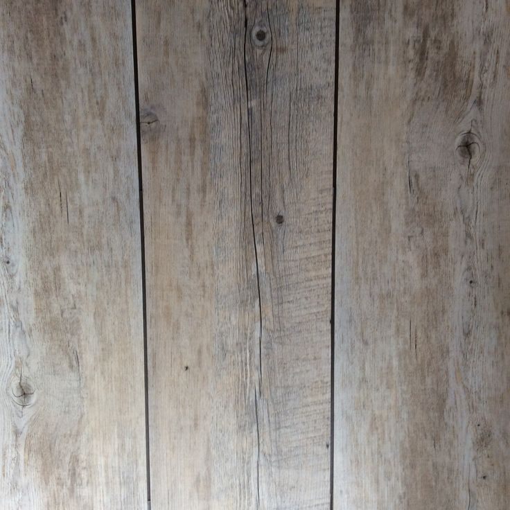 Karndean Van Gogh in Distressed Oak with DS06 design strips laid in 'ship's deck' style.