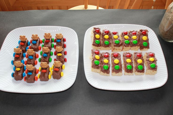 Car Theme: Teddy Graham Cars are made with fun size Snickers, M and Ms for the wheels and steering wheel (half of M and M), and melted chocolate chips to hold the wheels and Teddy Grahams in place. Traffic Lights are made with Rice Krispie bars, chocolate frosting, and M and Ms.  So much fun to make!
