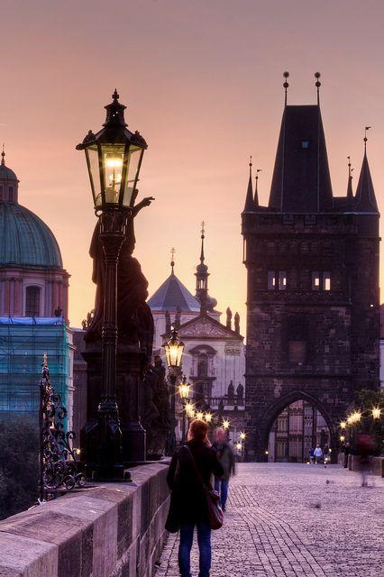 Strolling on Charles Bridge at dawn in Prague, Czech Republic