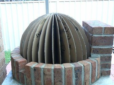 Build Your Own Pizza Oven. Thats a very cool idea to support the bricks as the mortar sets.