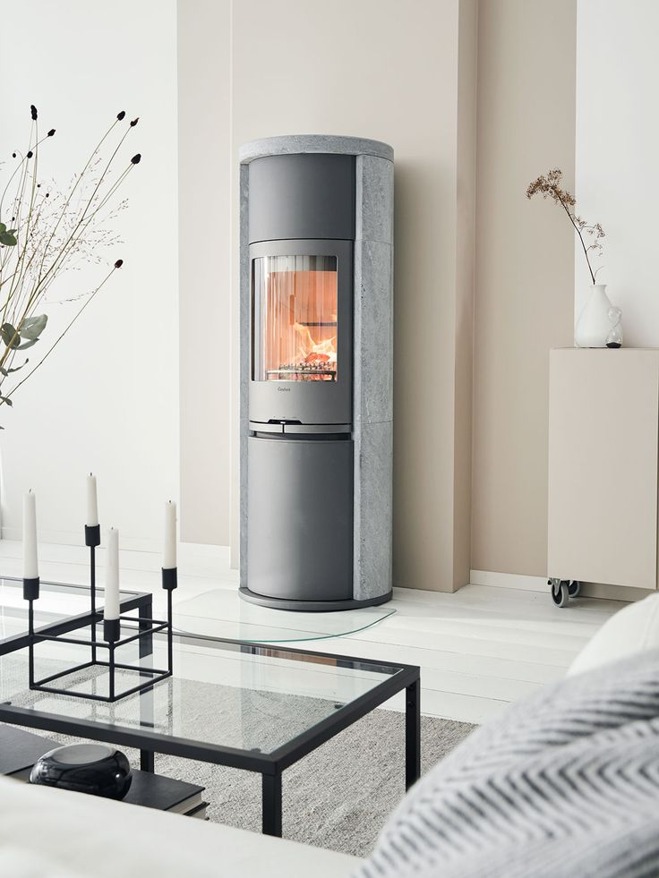 Contura 690T Style with soapstone. With a soapstone surround the stove can remain warm for several hours after the embers have died. #interiordesignideas #nordichomes #scandinavianhomes #madeinsweden #woodburner #contura600 #conturastyle