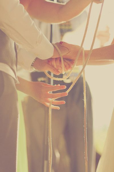 Ali and Emily's handfasting. Photo by Matt Miller at Our Labor of Love