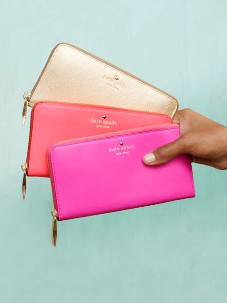 A Golden, Coral and Pink Kate Spade Wallet.