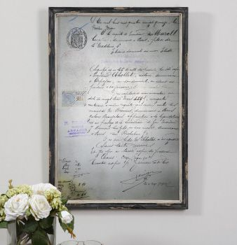 Replica of an 1800's hand-written French correspondence letter printed on an antiqued mirror encased in a heavily distressed black frame.  Uttermost