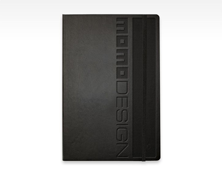 MOMODESIGN black notebook with logo embossed and textured.  Carnet de notes MOMODESIGN avec logo embossé et texturé.