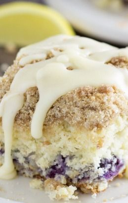 Blueberry Cinnamon Roll Cake ~ A blueberry cake with a hint of lemon, a cinnamon streusel, and cream cheese glaze. This dessert cake tastes like a blueberry flavored cinnamon roll in cake form!
