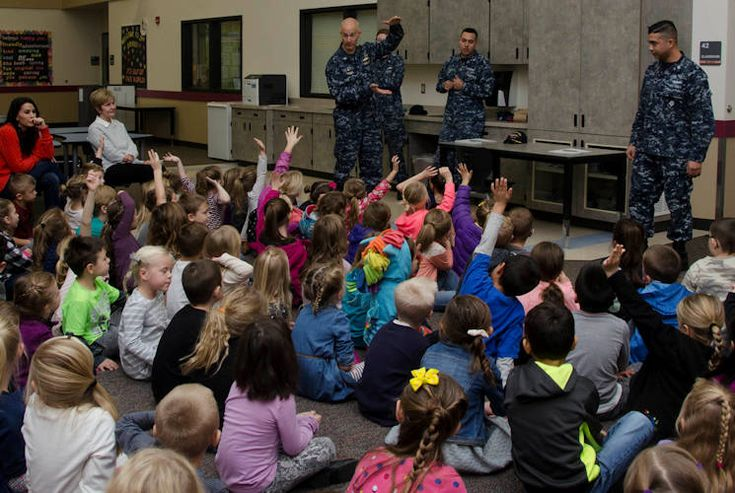 Sailors joined the commanding officer from the submarine tender USS Frank Cable for a visit to Captain Strong Primary School for their Veteran's Day celebration in Battle Ground, Washington.