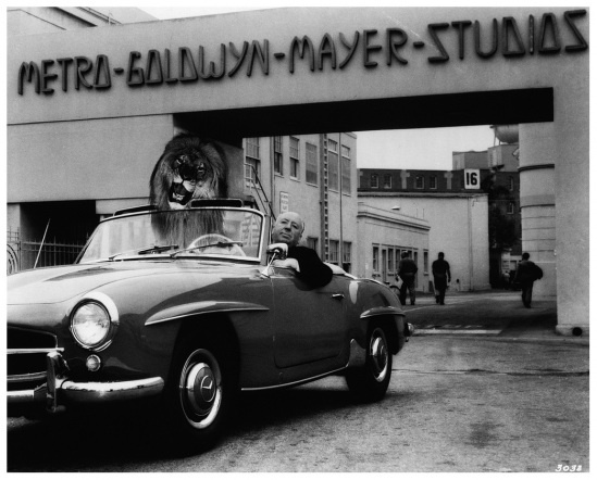 Director Alfred Hitchcock and Leo the Lion, MGM's mascot, share a Mercedes in front of Metro-Goldwyn-Mayer's Culver City studios: 1958/59.