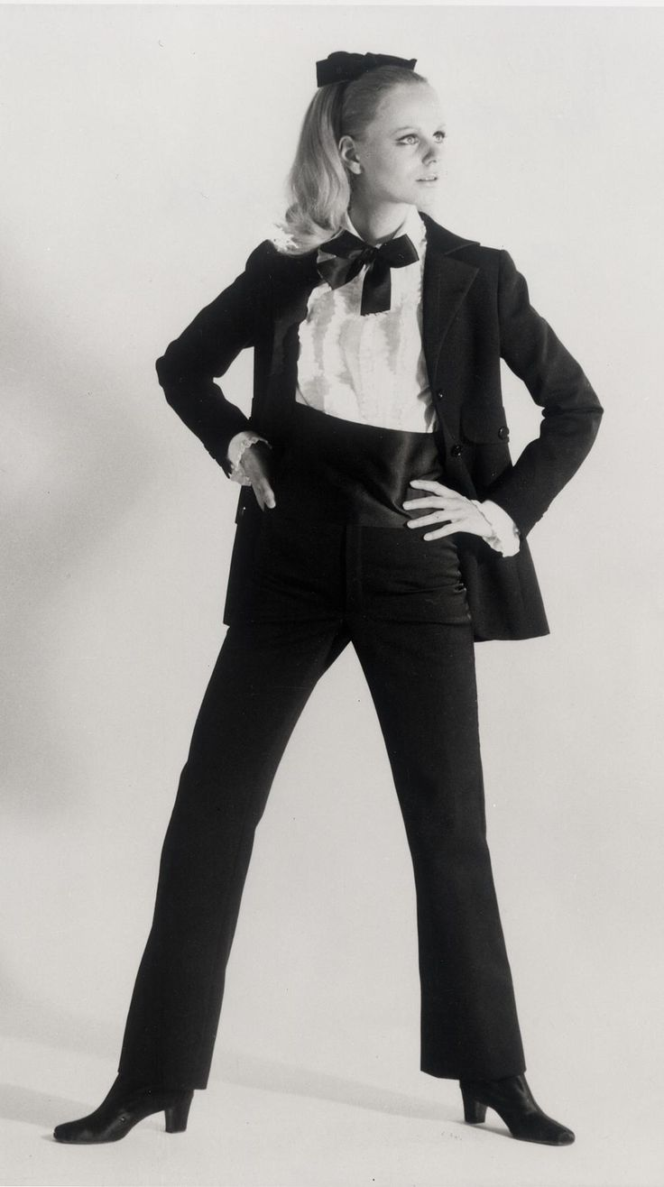 When Yves Saint Laurent debuted le smoking, a menswear-inspired tuxedo tailored for the chicer sex, women wearing pantsuits was still considered radical on both sides of the Atlantic. In a favorite fashion anecdote, a smoking clad Nan Kempner was denied entry to Manhattan's La Côte Basque in 1968. Skirting the dress code, Kempner removed her pants and sauntered into the restaurant wearing her smoking jacket as a minidress.
