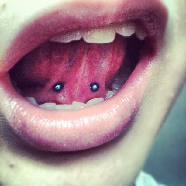 tongue web piercing... had this done for a few years now and still love it