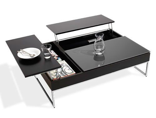 50 The Most Modern And Stylish Coffee Tables | Shelterness (This one is too sleek for me by far - it would be constantly covered with fingerprints in my house - but I love the mechanics of it; perhaps it could be constructed with wood.)