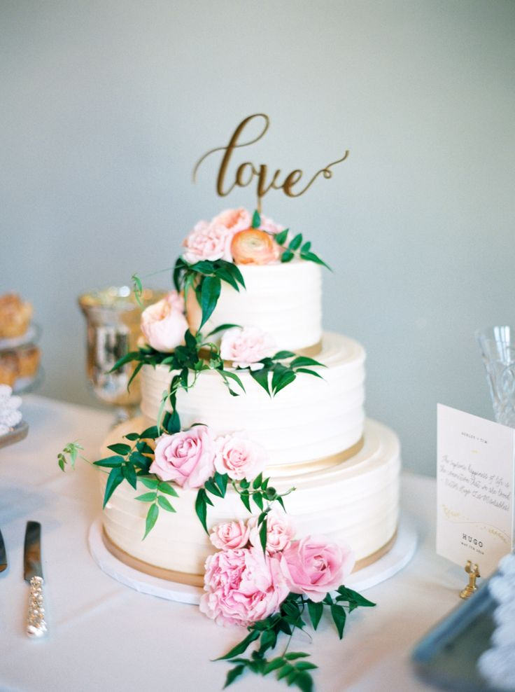 Three tier love topped wedding cake covered in beautiful flowers: Photography: Loft Photography - www.loftphotography.com/   Read More on SMP: http://www.stylemepretty.com/2016/06/28//