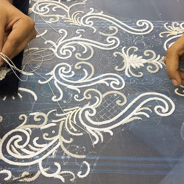 Making an embellished bridal gown involves a lot of #teamwork ... Here, Raju and Romjan, two of our embroidery #artisans are working on a #bodice piece | beading in white and silver| #handembroidery #craftsmanship #embroidery #design #handmade #weddinggown #curves and #lines #wedding #bridal #bridalfashion #fashion #embellishments #heirloom #weddingdress